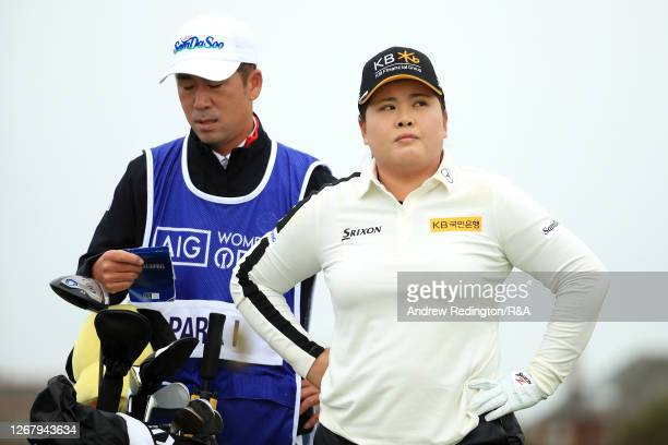 Inbee Park of South Korea and her husband and caddie Gi Hyeob Nam look on from the 1st tee during Day Four of the 2020 AIG Women's Open at Royal...
