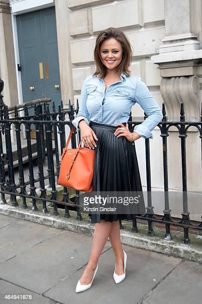 Inbetweeners actress Emily Atack wears a Topshop shirt and skirt Micheal Kors bag and Dorothy Perkins shoes on February 24 2015 in London England