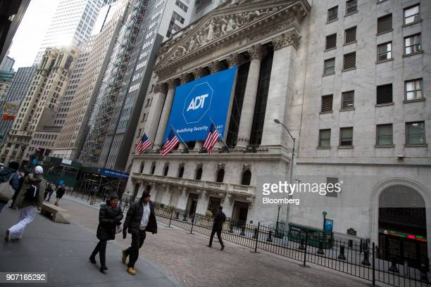 ADT Inc signage is displayed during the company's initial public offering at the New York Stock Exchange in New York US on Friday Jan 19 2018 US...