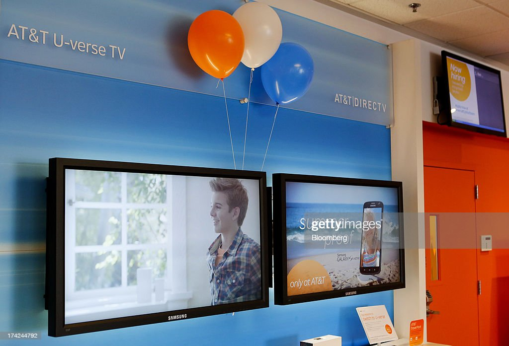 Inc. U-verse TV systems are displayed for sale at a store in Manhattan Beach, California, U.S., on Monday, July 22, 2013. AT&T Inc. is scheduled to release earnings figures on July 23. Photographer: Patrick T. Fallon/Bloomberg via Getty Images