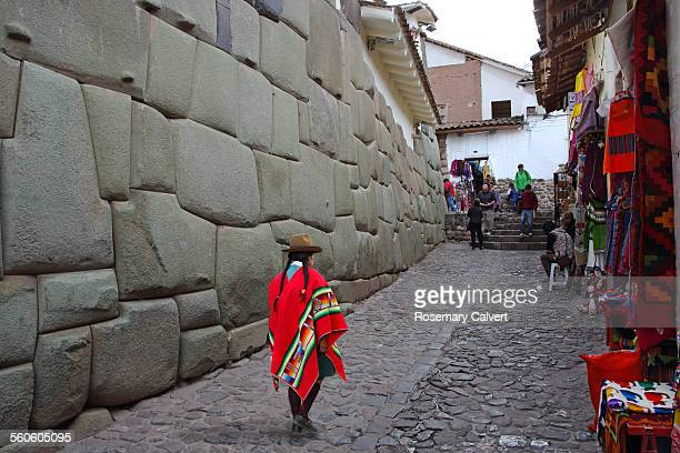 inca granite wall with shops - poncho stock pictures, royalty-free photos & images