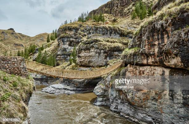 inca rope bridge crossing river ravine, huinchiri, cusco, peru - suspension bridge stock pictures, royalty-free photos & images