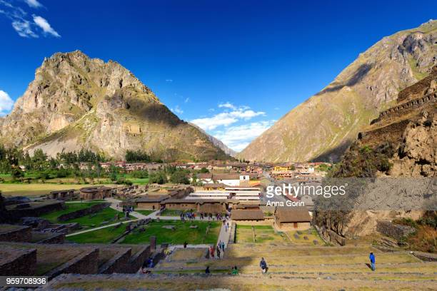 Inca terraces of Ollantaytambo in Sacred Valley of Peru, looking across town to Pinkuylluna mountain, autumn afternoon