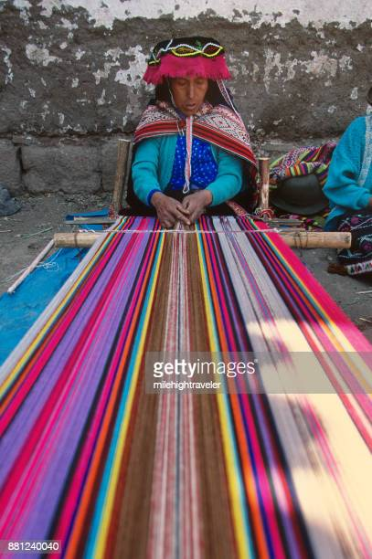 Inca traditional dress woman colorful native weaver backstrap loom Pisac Peru
