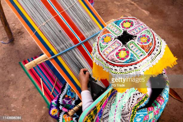 inca woman weaving alpaca wool - quechua people stock pictures, royalty-free photos & images