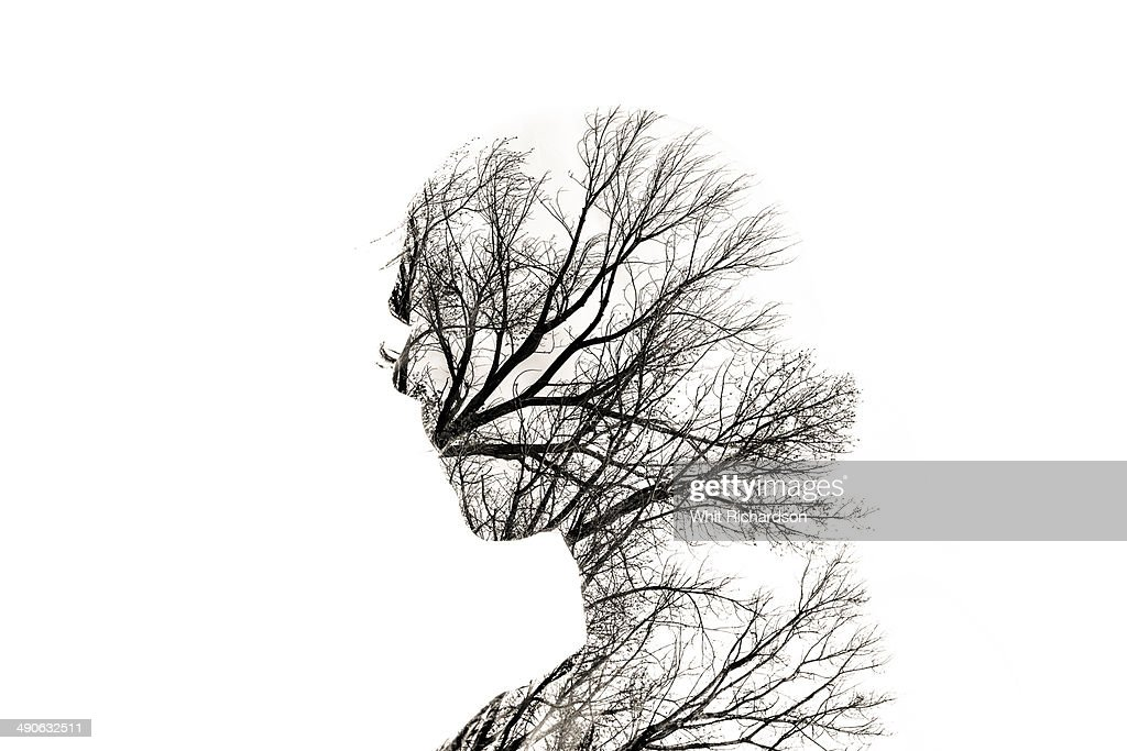 In-camera double exposure of woman and trees. : Stock Photo