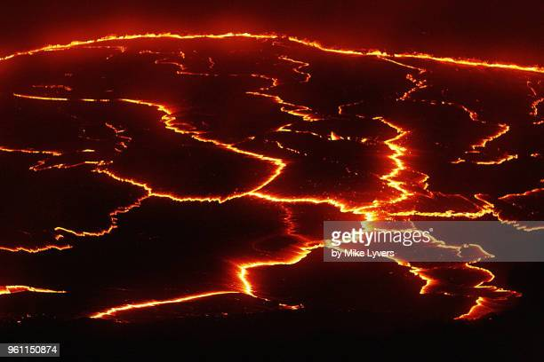 incandescent cracks in the surface skin of the lava lake during a calm period - pu'u o'o vent stock pictures, royalty-free photos & images