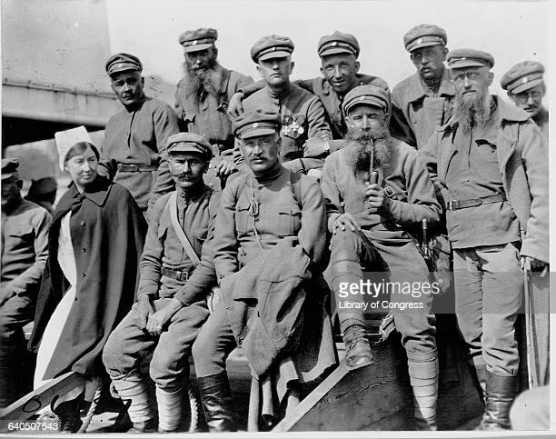 Incapacitated Czech soldiers sit with a Red Cross nurse following World War I 1919