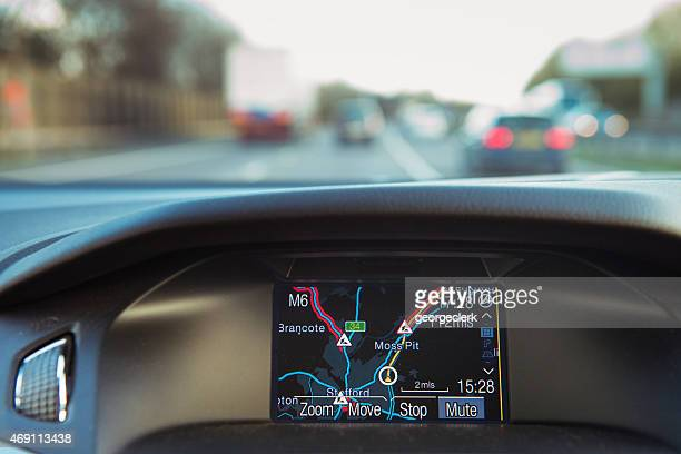In-car Sateillite Navigation in use on the road.