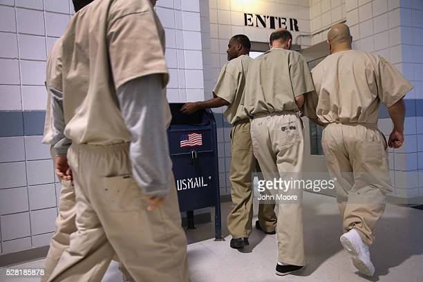 Incarcerated military veterans enter the dining hall for lunch at the Cybulski Rehabilitation Center on May 3 2016 in Enfield Connecticut The...