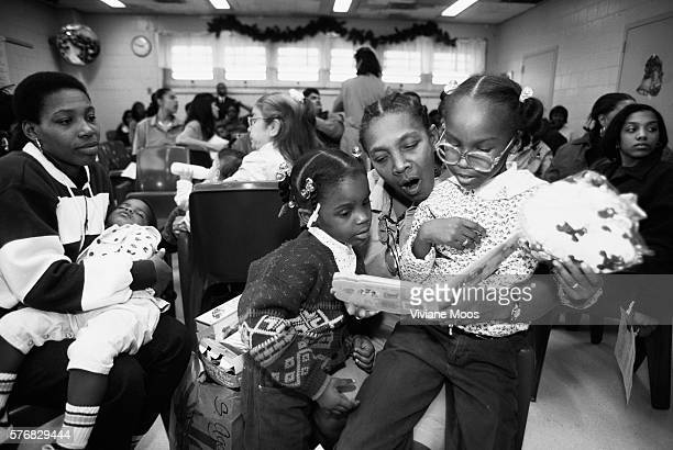 Incarcerated mothers visit with their families at a Christmas party at Rikers Island Prison | Location Rikers Island New York USA