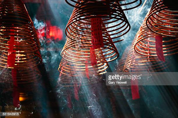 incense burners in man mo temple, hong kong - incense coils stock photos and pictures