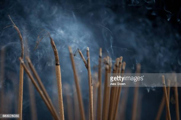 incense burning at vietnamese temple - incense stock photos and pictures