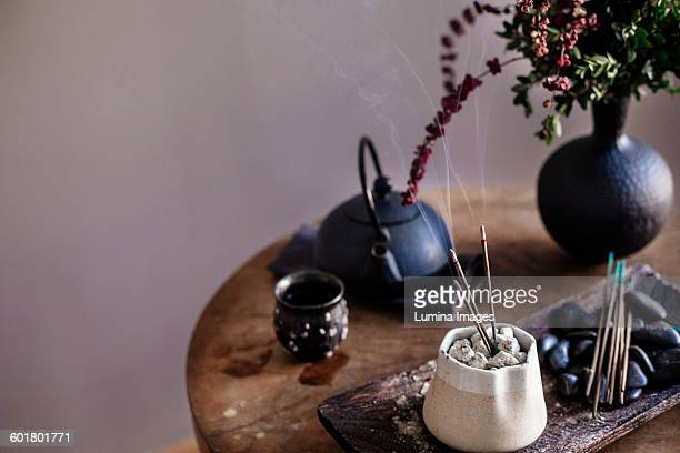 Incense burning on table