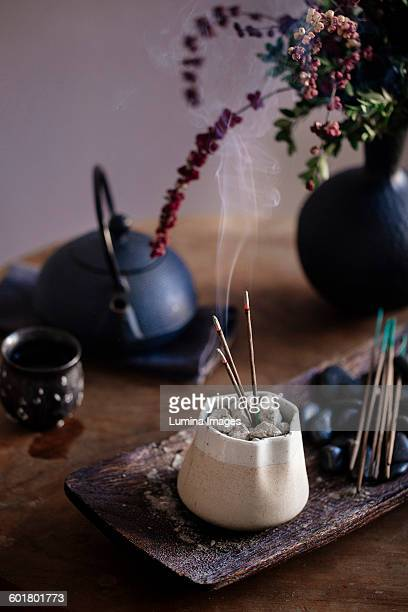 incense burning on table - incense stock pictures, royalty-free photos & images