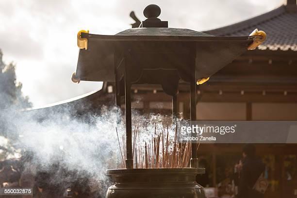 incense burning outside a temple in kyoto, japan - seijin no hi fotografías e imágenes de stock