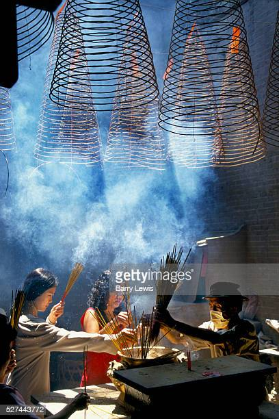 Incense coils are burnt as an offering to the sea goddess in a temple in Ho Chi Minh City in Vietnam