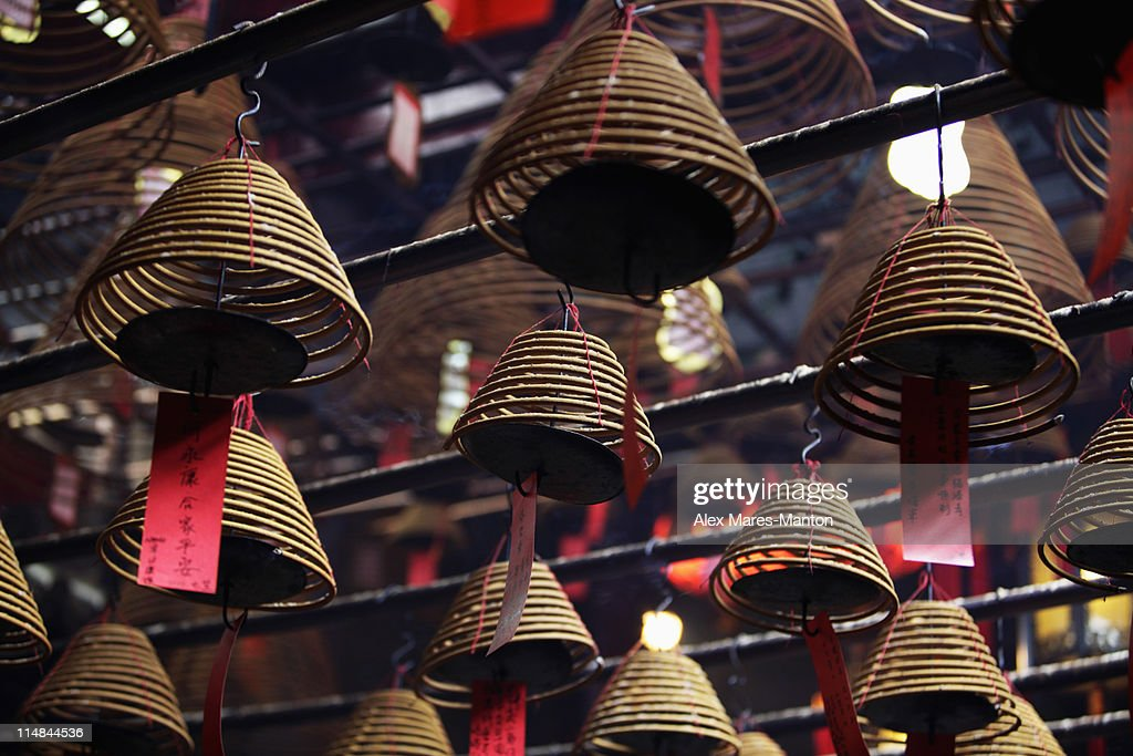 Incense coils hanging from ceiling. Man Mo Temple, Hong Kong : Stock Photo