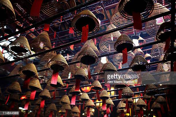 incense coils hanging from ceiling of man mo temple, hong kong - incense coils stock photos and pictures