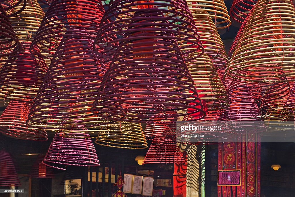 Incense coils hanging from ceiling : Stock Photo