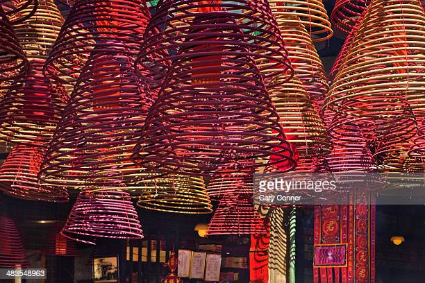 incense coils hanging from ceiling - incense coils stock photos and pictures