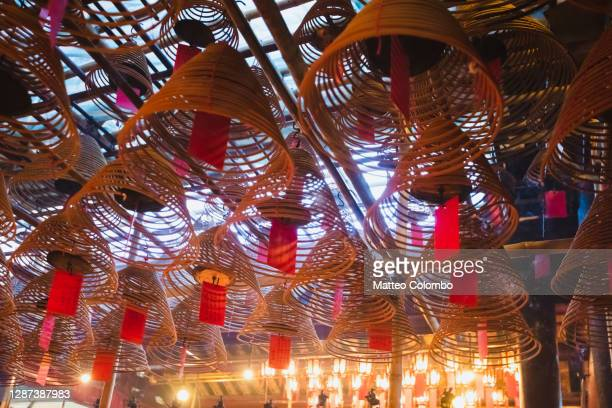 incense coils hanging from the ceiling, hong kong - incense coils stock pictures, royalty-free photos & images
