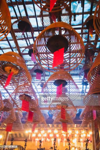 incense coils hanging from the ceiling, man mo temple - incense coils stock pictures, royalty-free photos & images