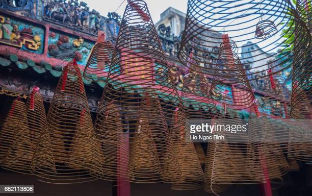 saigon, vietnam - may 18, 2017: incense coils in thien hau pagoda in chinatown. - thien hau pagoda stock pictures, royalty-free photos & images