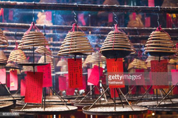 incense coils in tin hau temple - incense stock photos and pictures