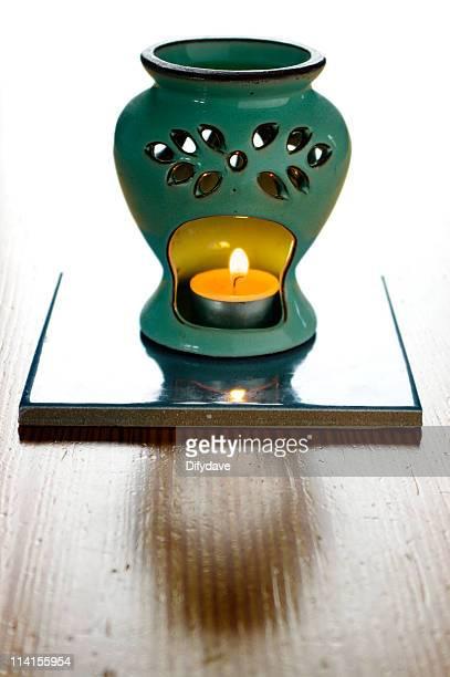 Incense Oil Burner On Wooden Table