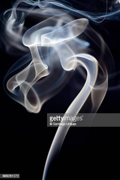 incense smoke against a black background - wispy stock photos and pictures