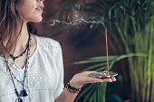 Incense Stick. Caucasian Woman Enjoying Aroma Stick