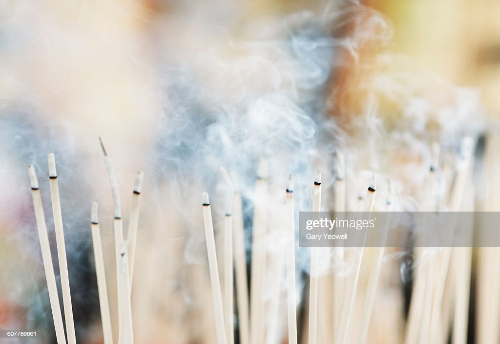 Incense sticks burning in a Buddhist temple : Stock Photo