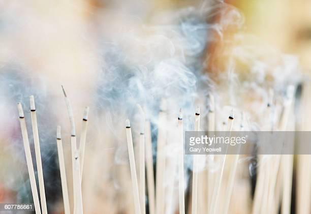incense sticks burning in a buddhist temple - incense stock photos and pictures