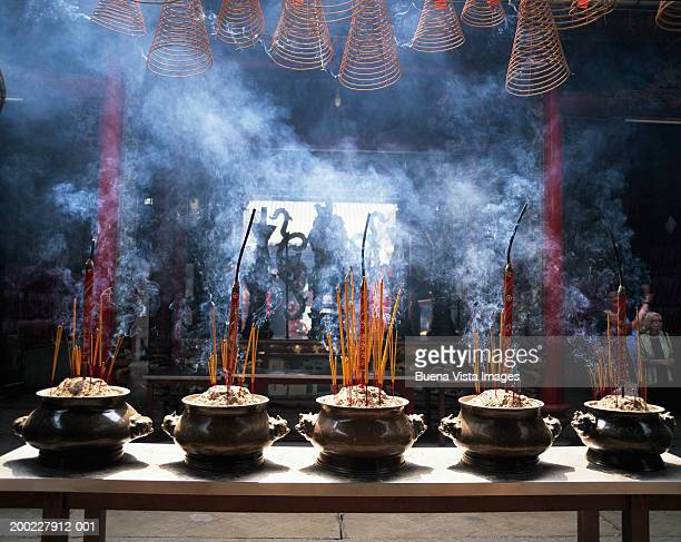 incense sticks burning in pots - thien hau pagoda stock pictures, royalty-free photos & images