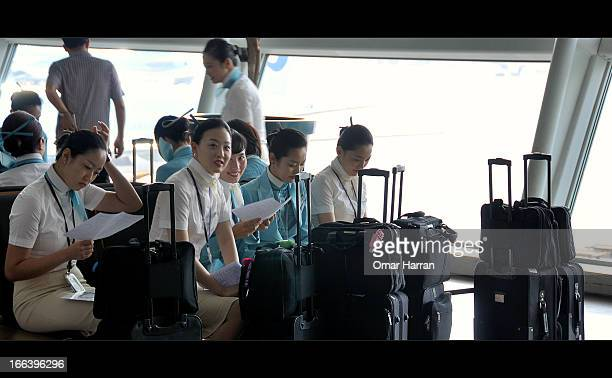 CONTENT] Incheon International Airport South Korea Air flight attendant morning rush Boeing B777 texting mobile phones cell waiting Last leg of my...