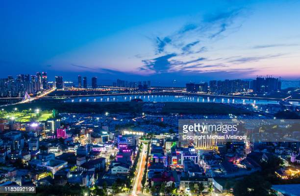 incheon songdo cityscape at night - songdo ibd stock pictures, royalty-free photos & images