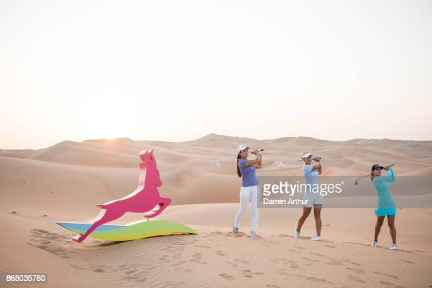 Inci Mehmet of England Amy Boulden of Wales and Belén Mozo of Spain pose on sand dunes ahead of the Fatima Bint Mubarak Ladies Open on October 28...