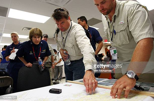 Incident Commander for Louisiana Brian Bauer goes over a map of the Plaquemines Parish area before conducting a survey tour near the Southwest Pass...