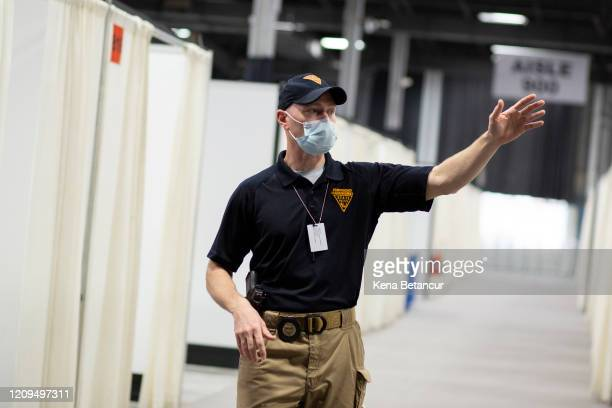 Incident Commander Marc Pellegrino talk to Members of the media during a tour inside the New Jersey Convention Center on April 8, 2020 in Edison, New...