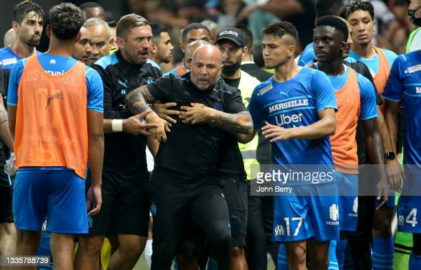 Incidents between the players of Marseille and the supporters of Nice who entered the pitch - here coach of OM Jorge Sampaoli being pushed back by...