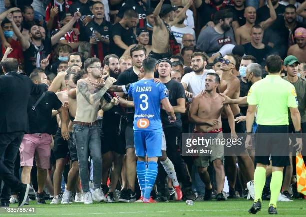 Incidents between the players of Marseille - here Alvaro Gonzalez of OM - and the supporters of Nice who entered the pitch during the Ligue 1 match...