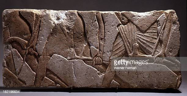 Incised block from an Amarna temple Sunk relief depicting soldiers holdign weapons Egypt Ancient Egyptian 18th dynasty c 1352 1336 BC