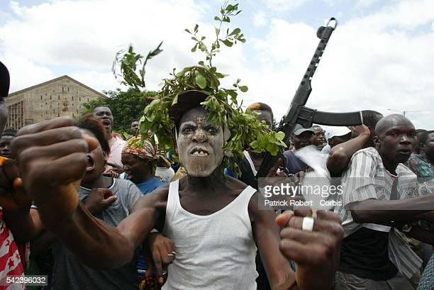 Incited to action by a group of rebels, the vociferous crowd protests against the French and the current system of government in the Ivory Coast.