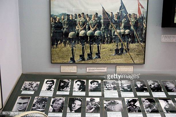 Included in the exhibition at the War Remnants Museum is a color photograph showing the burial of dead Marines with their helmets placed on their...