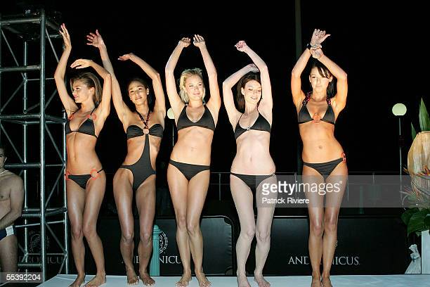 Models dance on the runway in Jodhi Mears's Tiger Lily swimsuit at the opening party for Nick's Bondi Beach Pavilion on September 13 2005 in Sydney...