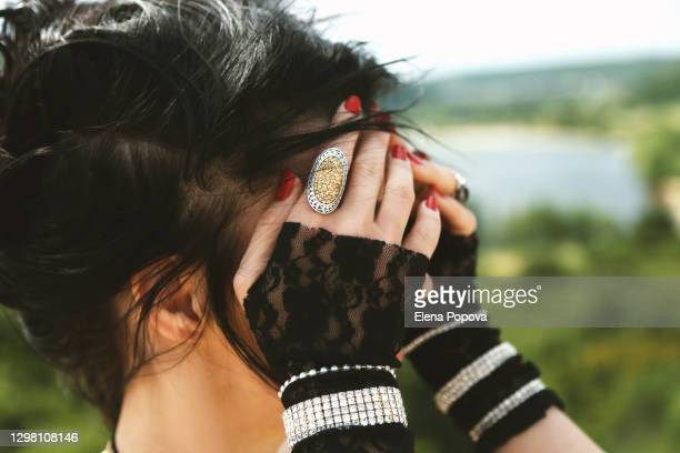incognito belly dancer woman hides her face by hands - lace glove stock pictures, royalty-free photos & images