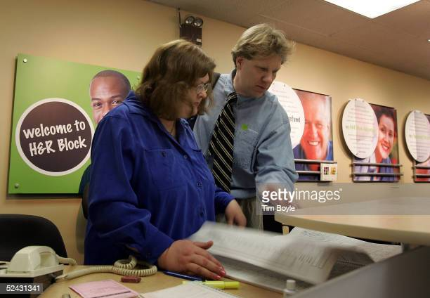 Income tax advisor M Jennifer Richards and tax associate William Trudell look at appointments at an HR Block location March 15 2005 in Des Plaines...