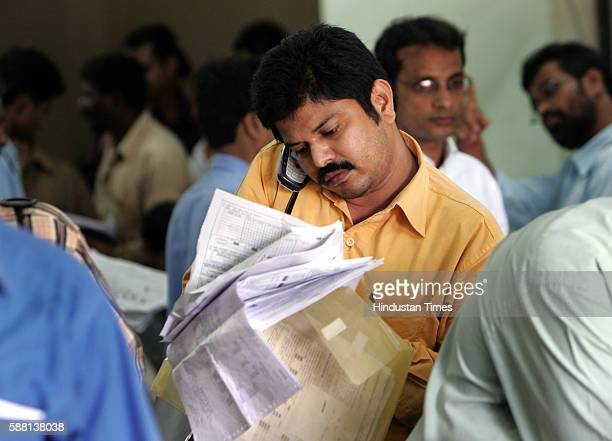 Income Tax Pallav a Chartered Accountant rummages through his multiple clients forms in a last minute checkup for accuracy before filing their income...