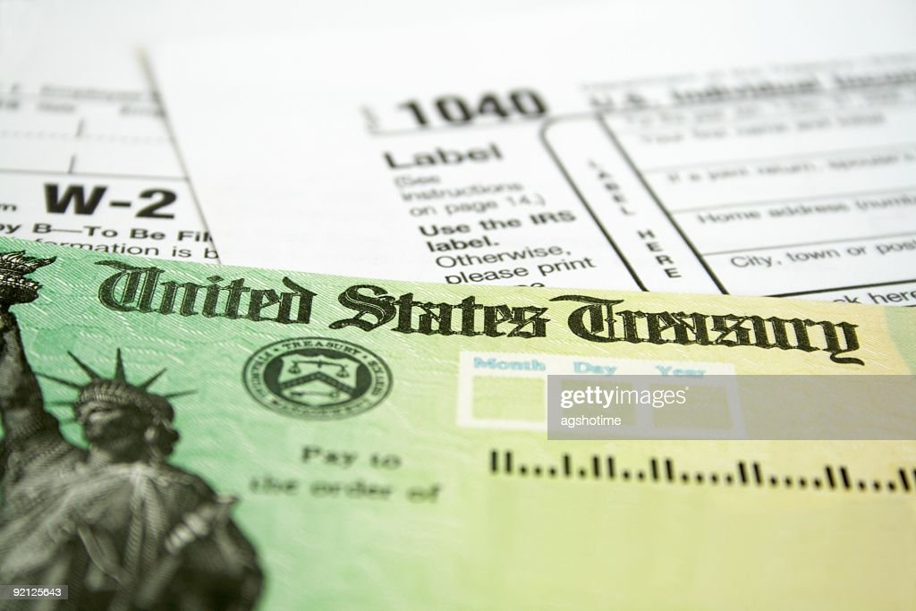 Income tax refund check on tax forms : Stock Photo